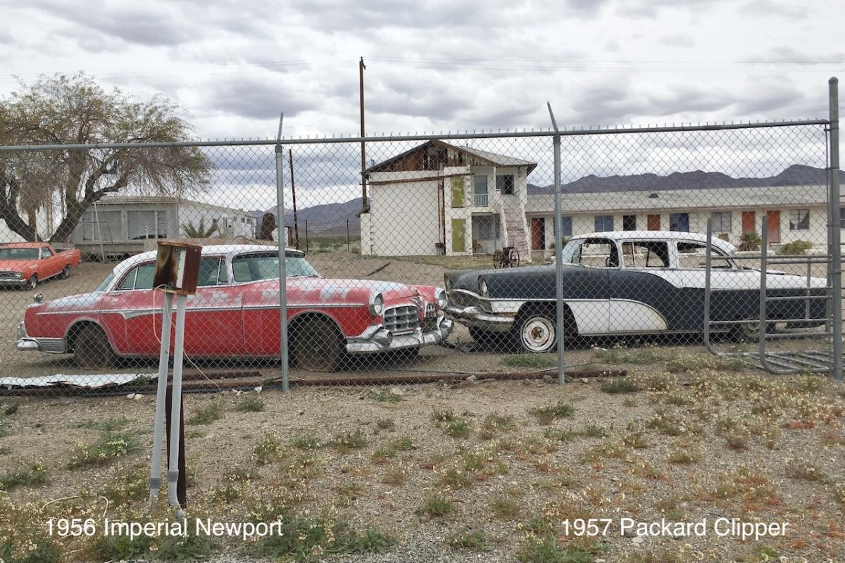 1955 Imperial Newport and 1957 Packard Clipper at Roys Motel and Cafe